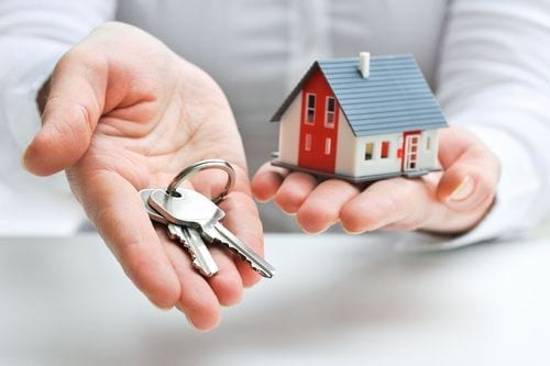 house in left hand keys in right hand